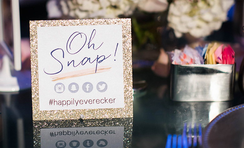 Oh Snap! on sign with hashtag #happilyeverecker