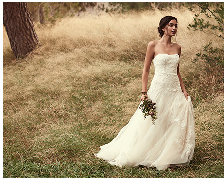 Bride wearing a Melissa Sweet tulle a-line gown with floral appliques