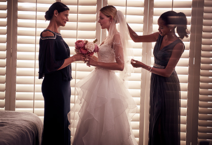 Traditional bride in formal gown with mother of bride and bridesmaid | David's Bridal