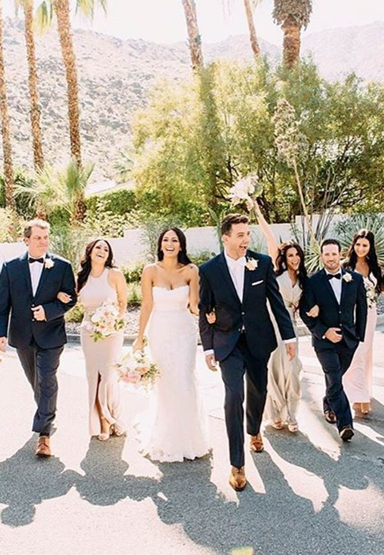 Bridal party walking down desert street