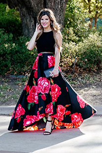 Instagram model wearig two piece high low ball gown with red flowers