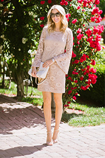 Instagram model wearing short bell sleeve lace sheath dress