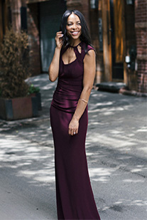 Instagram model wearing purple long dress with cutout neckline