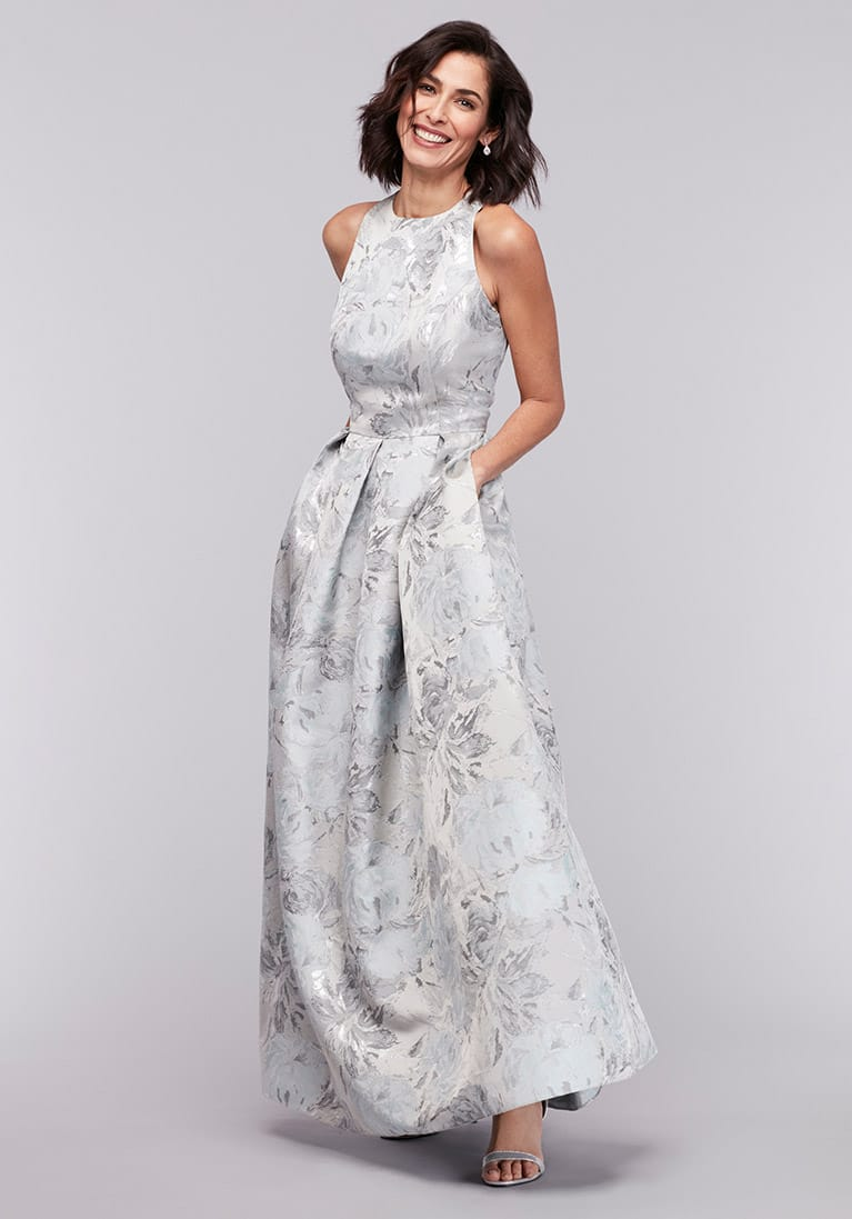 mom in long silver floral gown