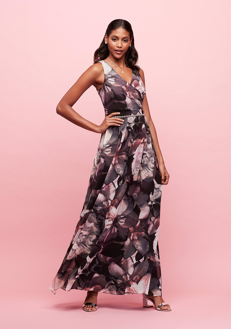 Purple floral chiffon surplice gown with beaded waist