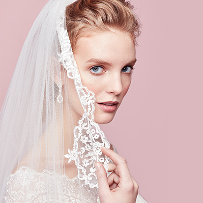 Bride touching veil lace embellishment