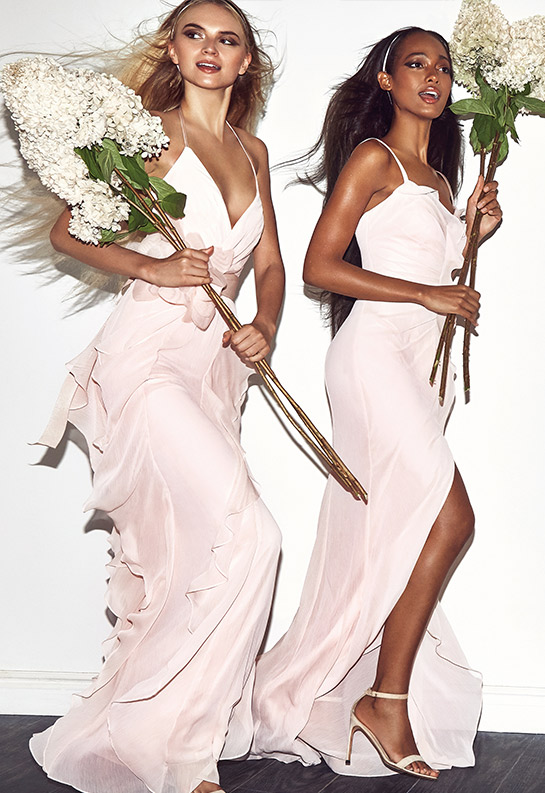 Bridesmaids wearing White by Vera Wang dresses with butterflies