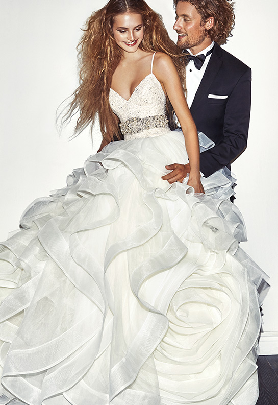 Groom and bride wearing White by Vera Wang