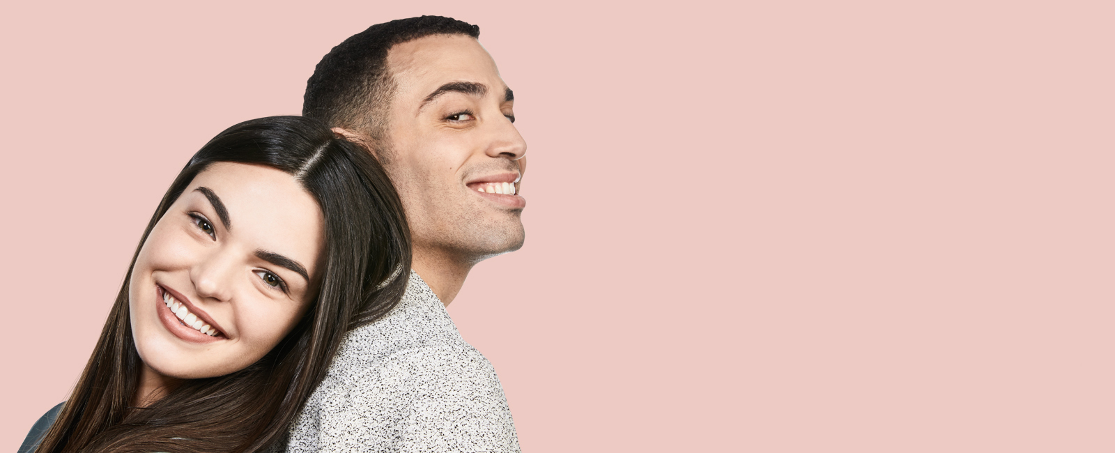 Couple smiling with pink background