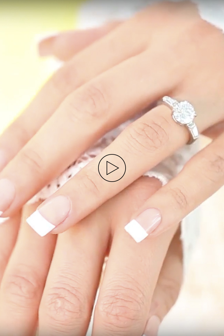 Bride with hands resting together showing off her french manicure