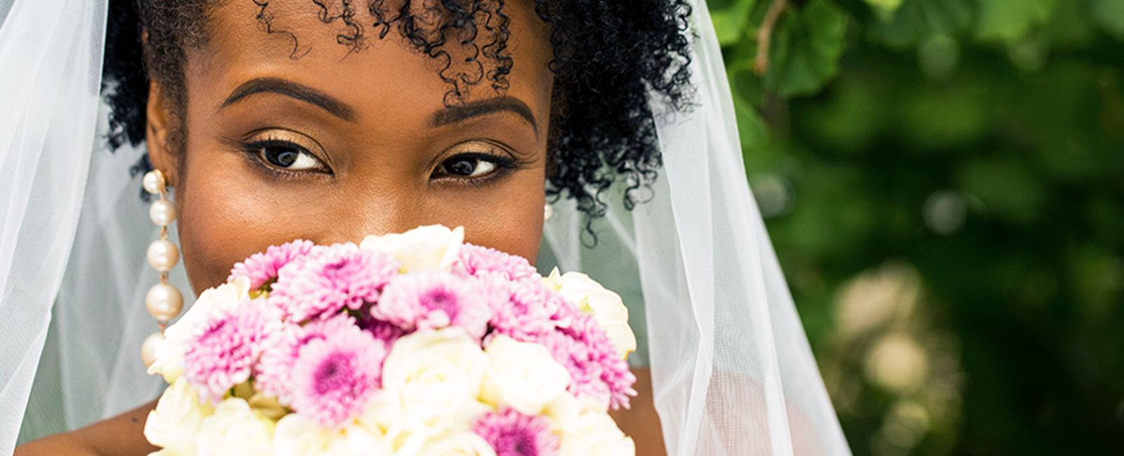 Bride sniffing a bouquet on her wedding day