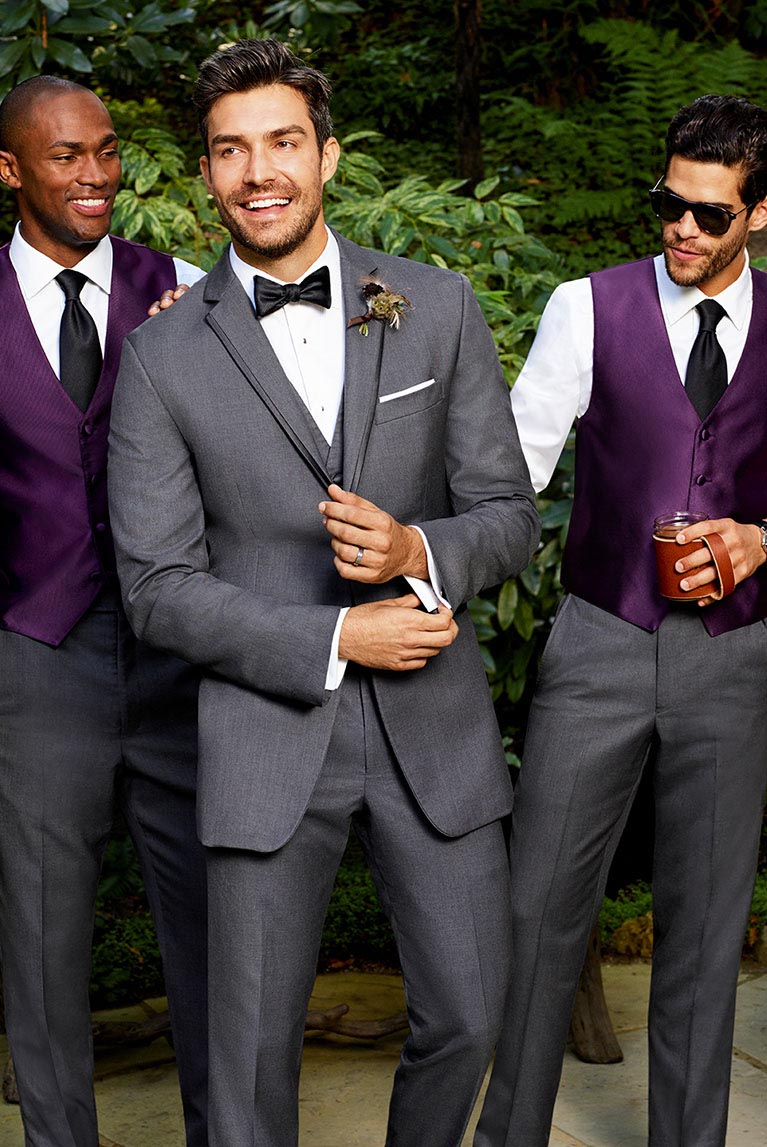 Groom and groomsmen in coordinating tux styles